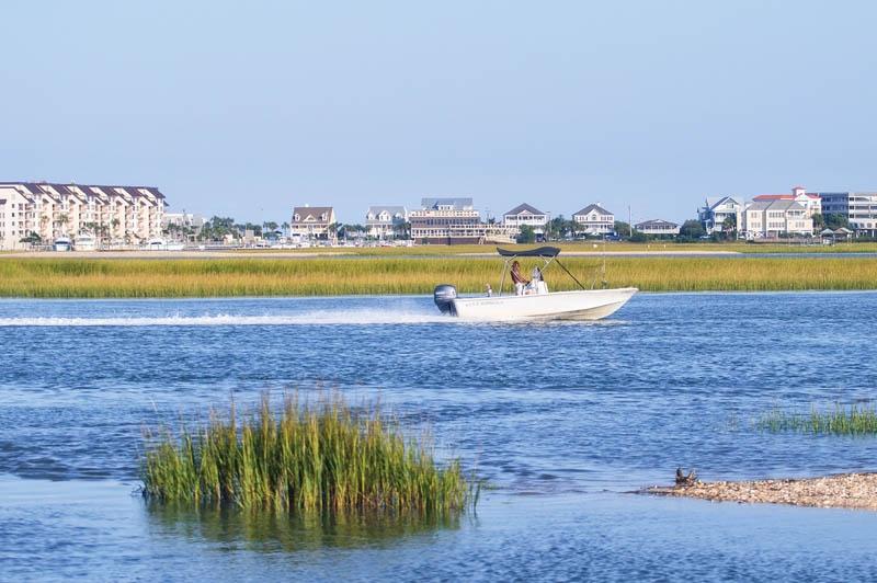 Book a charter and troll the Garden City coastline.