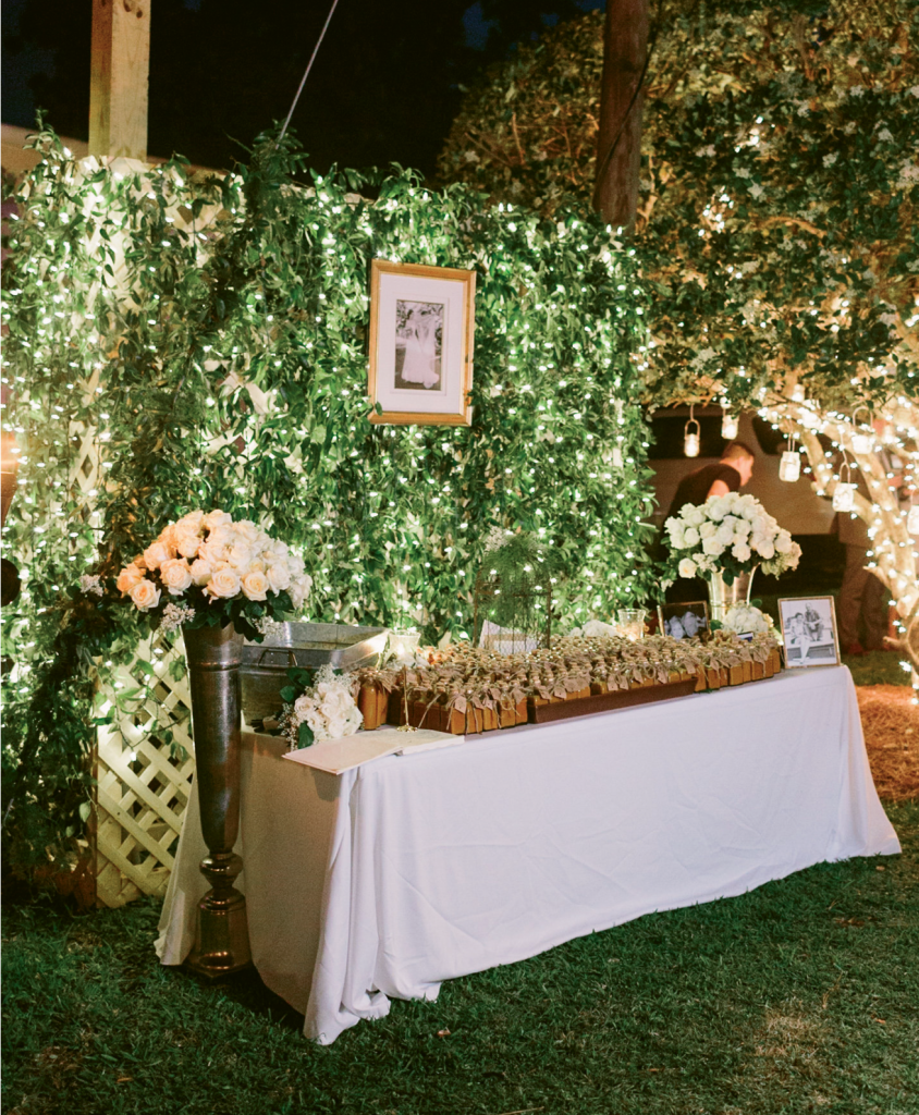 Her simple elegance theme was woven into the white lights strung from the trees and ivory bouquets.