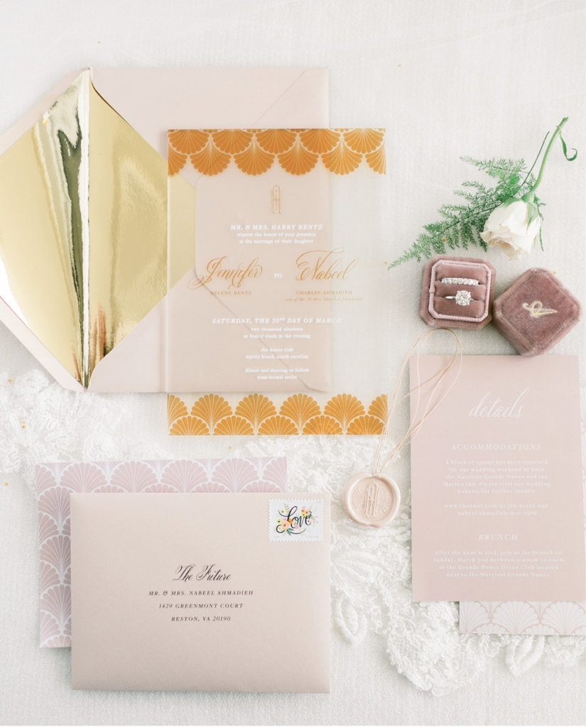The invitations by Lauren Skaare featured blush and gold.