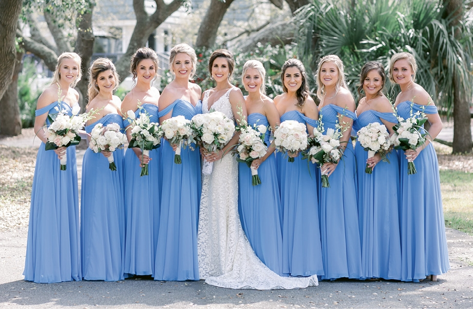 The bridesmaids donned cornflower blue gowns from The Dessy Group, a hue incorporated throughout the cocktail hour decor.