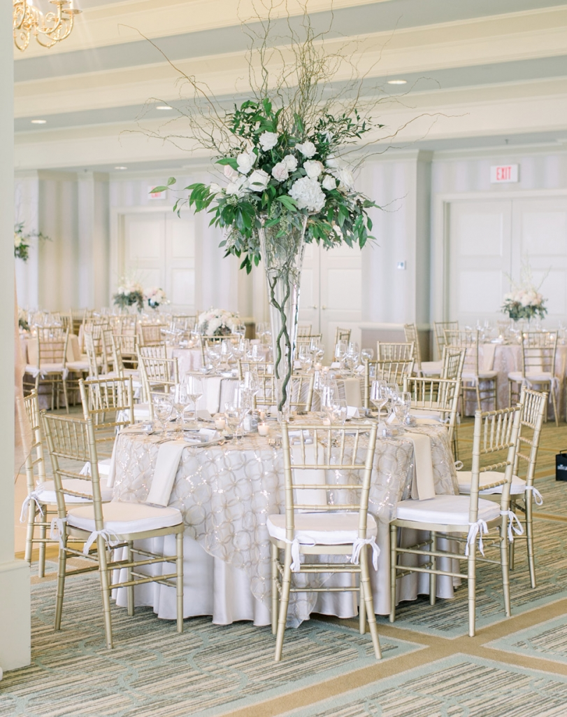 A greenery wall served as the perfect photo op for guests, and the large standing centerpieces added to the air of elegance.